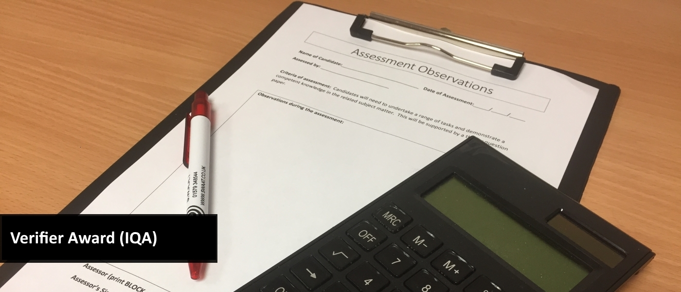Clipboard with assessment observations sheet, calculator and pen